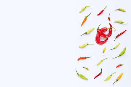 Different chili on white background. Copy space