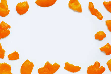 Frame made of mandarin peel isolated on white background