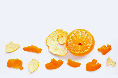 Orange with peel on white background. Copy space