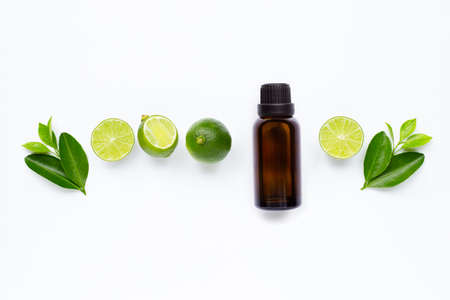 Essential oil with Limes and leaves isolated on white background. 写真素材