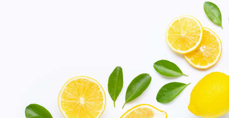 Frame made of fresh lemon and  slices with leaves isolated on white background.