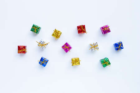 Mini gift boxes on white background. Top view