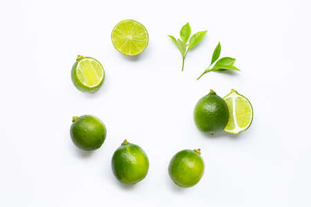 Limes with leaves isolated on white background.