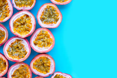 Passion fruit on blue background. Top view with copy space