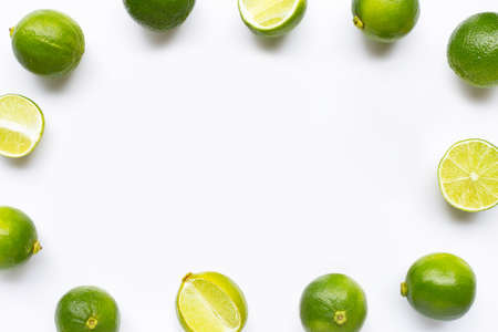 Frame made of limes isolated on white background. Copy space Stock Photo