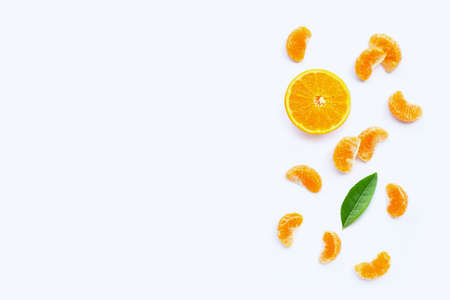 Mandarin segments, Fresh orange isolated on white background. Top view