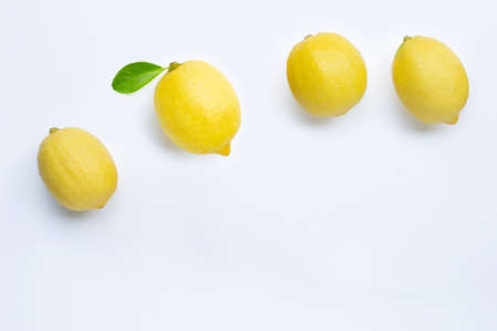Fresh lemons with green leaf on white background. Copy space