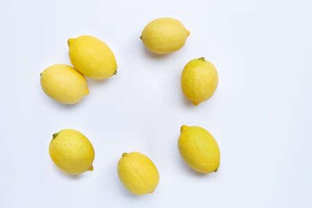 Frame made of fresh lemons on white background. Copy space