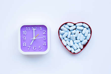 Clock  with PrEP ( Pre-Exposure Prophylaxis). used to prevent HIV. Top view Stock Photo