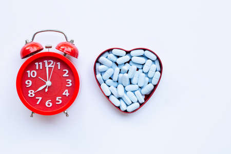 Red alarm clock ring with PrEP ( Pre-Exposure Prophylaxis). used to prevent HIV. Copy space
