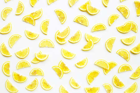 Fresh lemon  slices on white background. Copy space