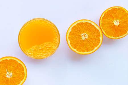 Fresh orange juice with orange fruit on white background. Copy space Stock Photo