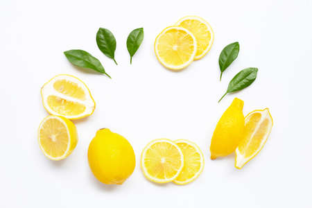 Frame made of fresh lemon with green leaves on white background.
