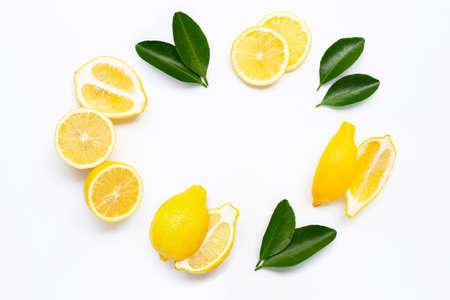 Fresh lemon with green leaves on white background. Stock Photo