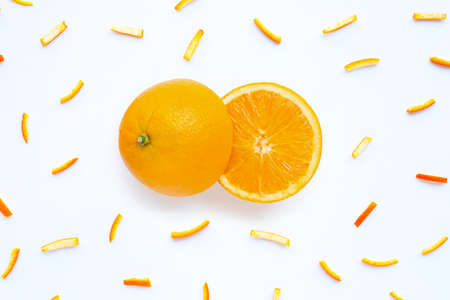 Orange with peels on white background. top view