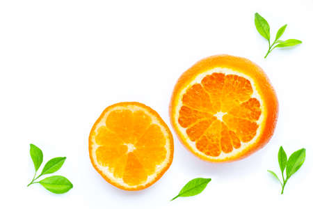 Fresh orange with leaves on white background. Copy space