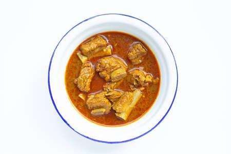 Spicy stir fried pork sparerib with Thai Southern chili paste on white background.
