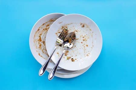 Dirty dishes on blue background. Top view
