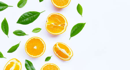 Oranges with leaves on white background. Copy space