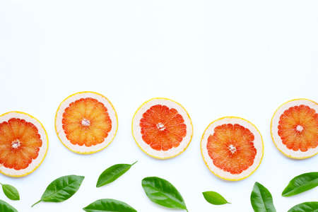 High vitamin C. Juicy grapefruit slices on white background.