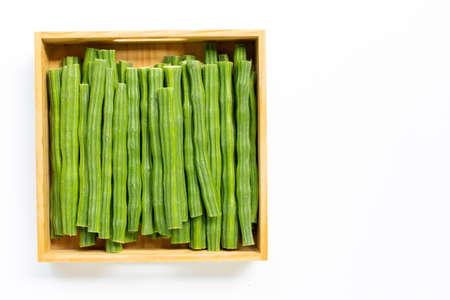Moringa oleifera in wooden box isolated on white background.