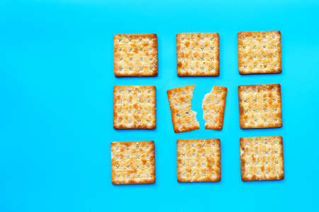 Crackers with sugar on blue background. Top view