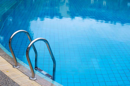 Outdoor swimming pool with stair Stockfoto