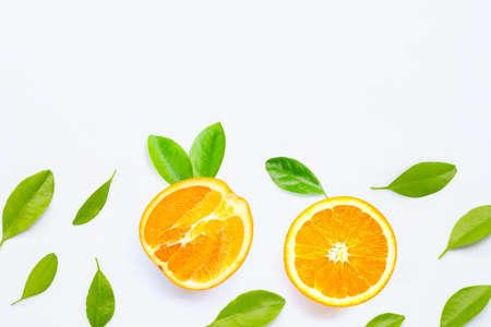 High vitamin C, JFresh orange fruit with green leaves  on white background.