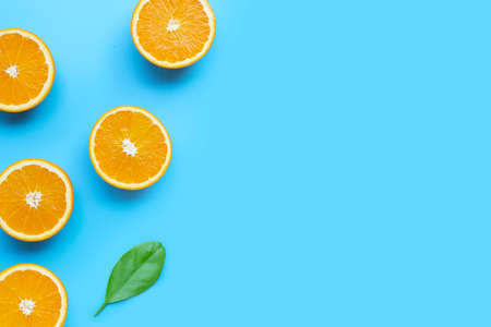 High vitamin C, Juicy and sweet. Fresh orange fruit on blue background. Top view Archivio Fotografico