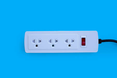 Electrical power strip on blue background. Top view