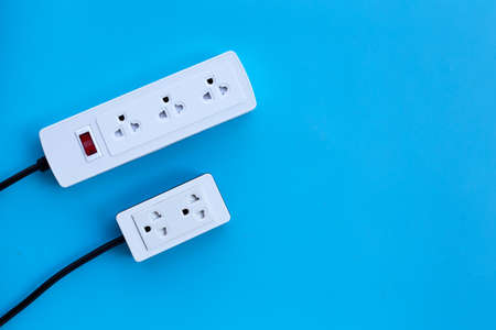 Two electrical power strip on blue background. Top view