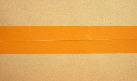 Brown cardboard box with tape