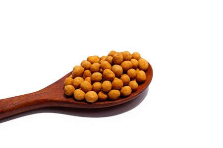 Crispy peanut snack balls on white background.