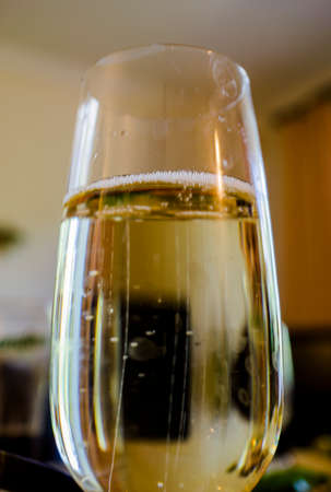macro photography: Glass of champagne with bubbles macro photography Stock Photo