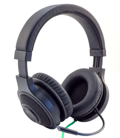 matt: Matt black headphones with a headset with a green wire cuted isolated on white