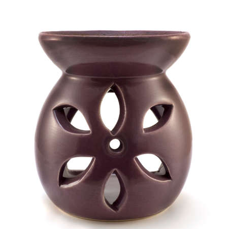 aromatherapy candle: Purple ceramic vase aromatherapy candle isolated on white