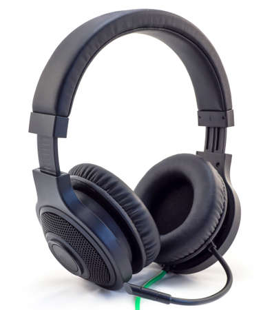 matt: Matt black headphones with a headset with a green wire isolated on white