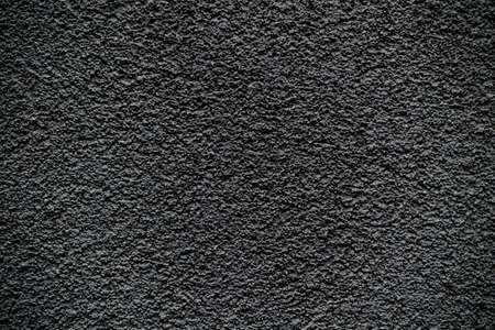 revetment: Black revetment wall putty macro texture background Stock Photo