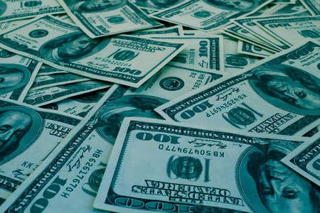 million dollars: Mount of hundred dollar banknotes background texture blue filtered