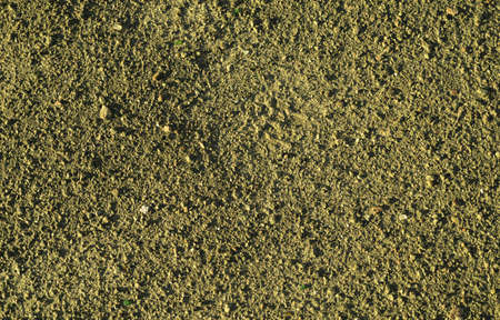 yellow earth: Yellow earth and gravel macro texture background Stock Photo
