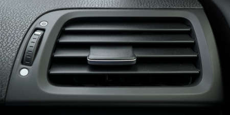 airflow: Black airflow tunnel way in the cabin of the modern car Stock Photo