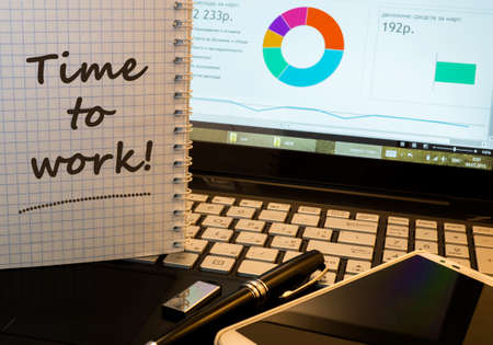 office time: Inscription - Time to work in notepad on office working place Stock Photo