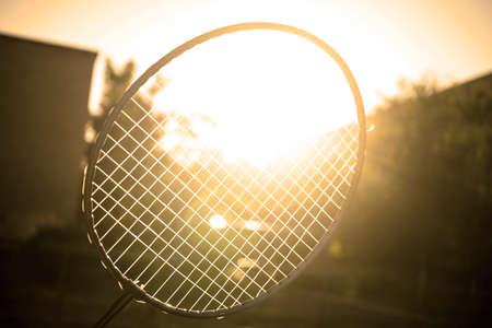 badminton racket: Tennis badminton racket under rays of sun glare bloom filtered background