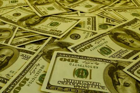 filtered: Mount of hundred dollar banknotes background texture warm filtered