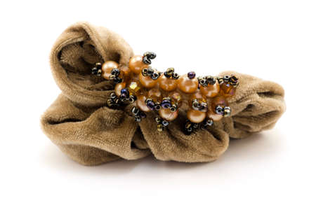 hairpin: Womens brown scrunchy hairpin with jewelry isolated ob white