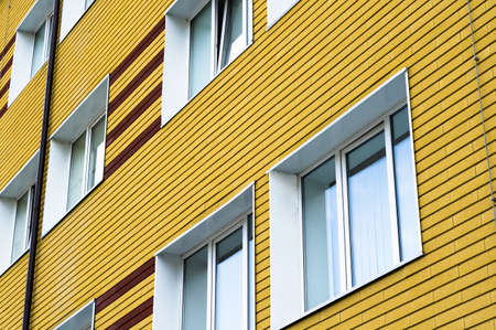 many windows: Many windows in yellow brick building Stock Photo