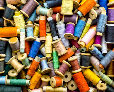 sewing box: Colored threads for sewing background