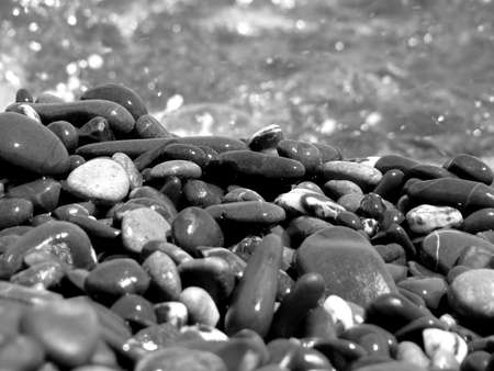 sea water: Stones on background of sea water with reflections black and white Stock Photo
