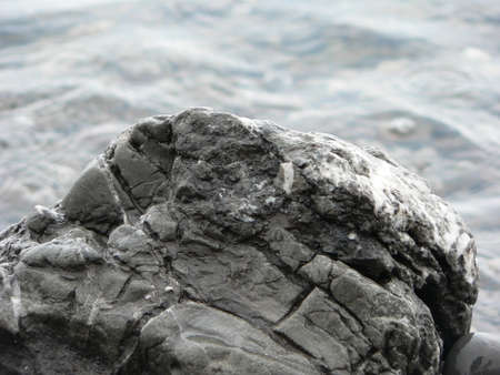 sea water: Gray stone on background of sea water