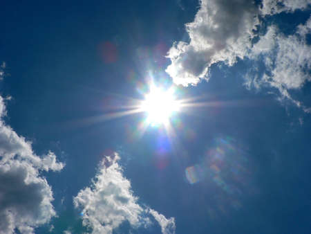comet: Cloudy blue sky and bright sun like a comet Stock Photo
